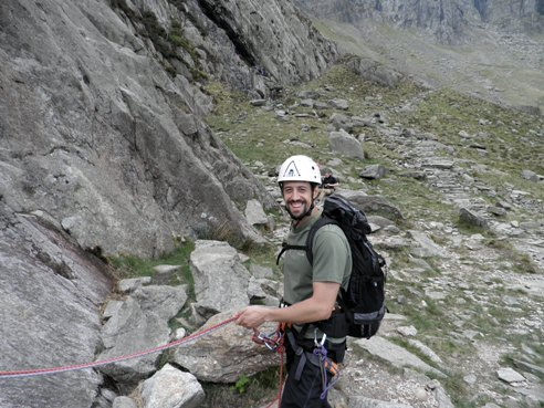 Huw belaying at the start of Charity.