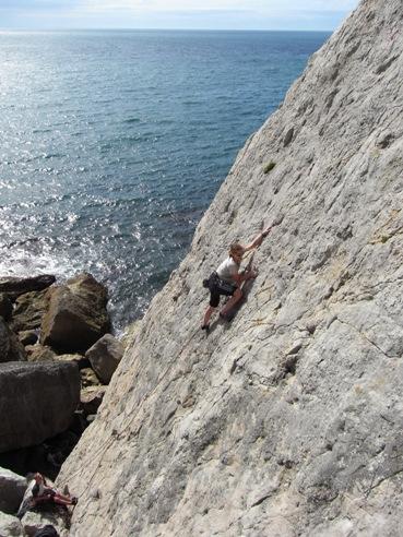Dagmar climbing Fallen Slab.