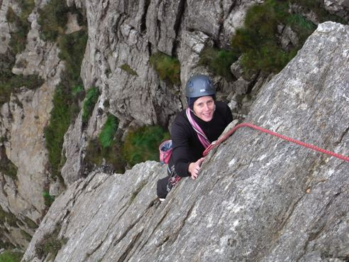 Paula climbing the 'delightfully exposed' slab and arete on Main Wall's 5th pitch.