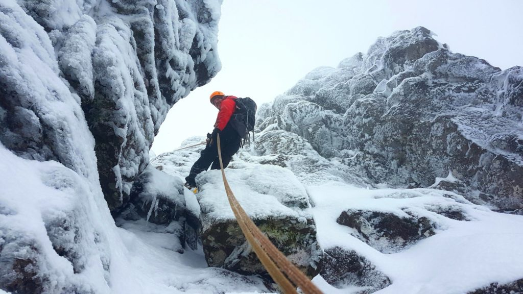 Abseiling in snow on Aonach Eagach, Glen Coe.