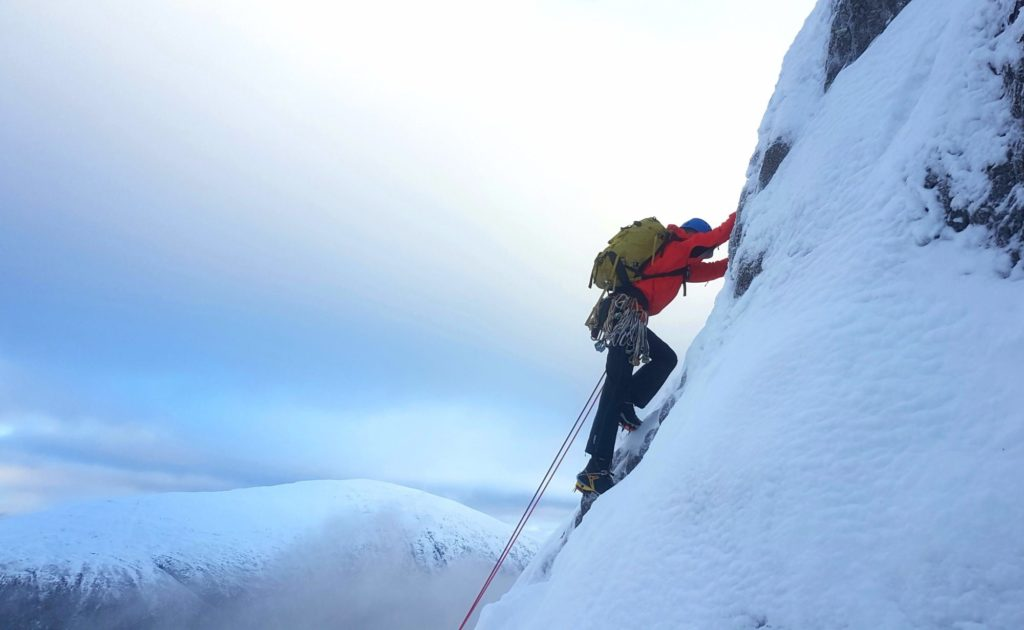 Winter climbing a steep snow covered slope on Buachaille Etive Mor, Glen Coe.