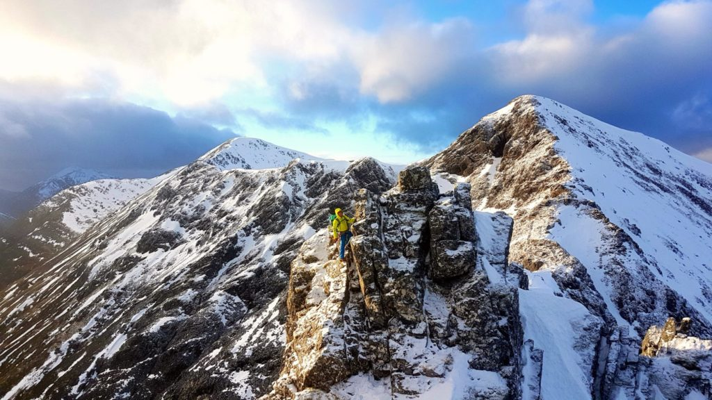 Mountaineering on a snow covered mountain summit in Glen Coe, Scotland.
