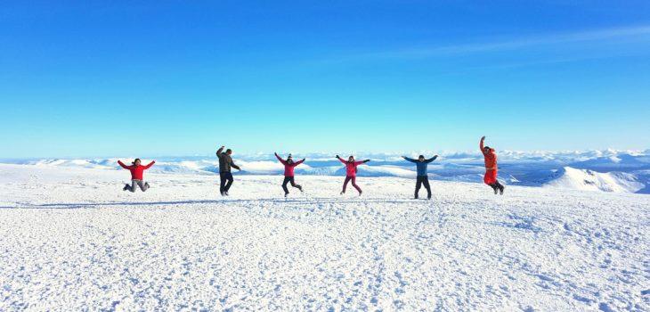 Walking group on the summit of Ben Nevis in Scotland.