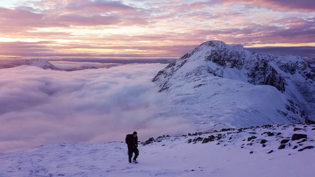 A walker above a temperature inversion in the Mamores mountains in Scotland.