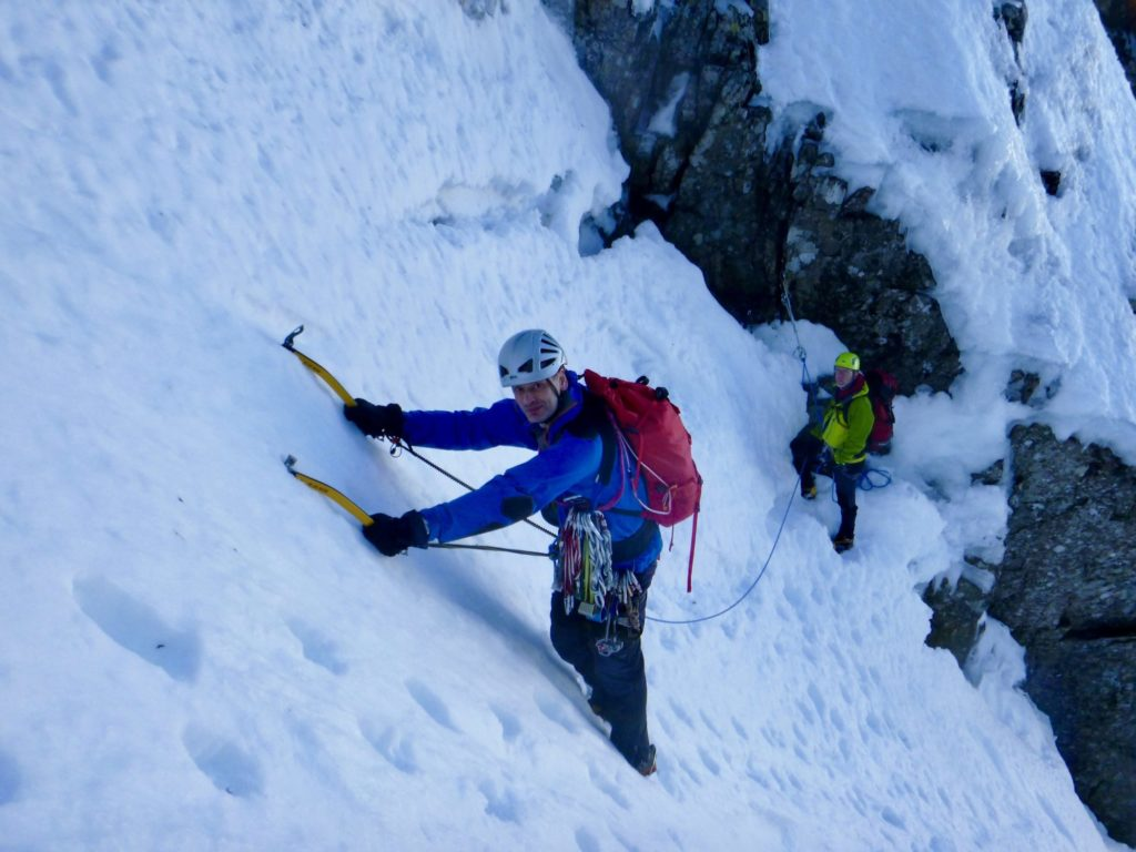 Winter climbers with ice axes on Ben Nevis, Scotland
